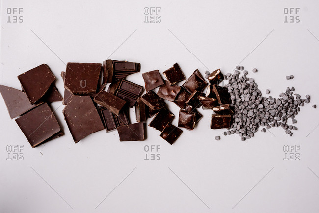 Variety of broken bars of chocolates laid out