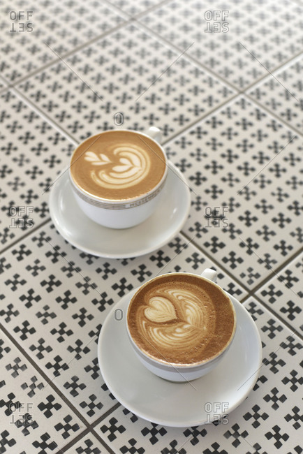 Two cups of decorative foamed espresso