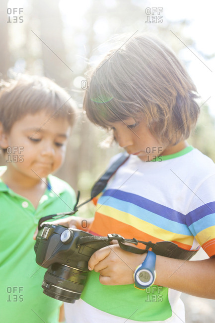 Brothers checking photos on camera screen