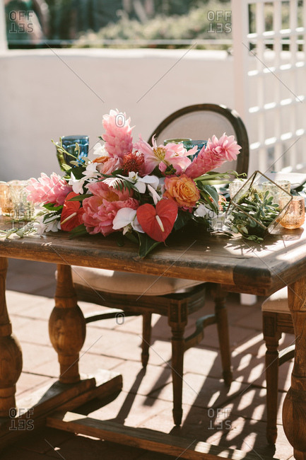 Eclectic bouquet spread on wooden table of honor