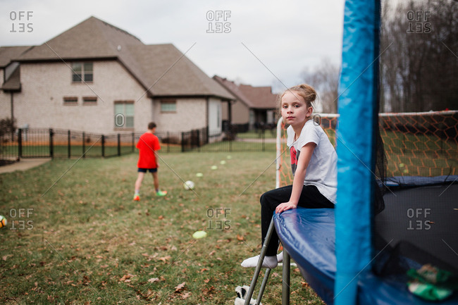 Girl sitting on the edge on trampoline