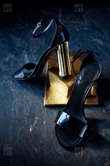 Strappy high heel sandals with a gold heel