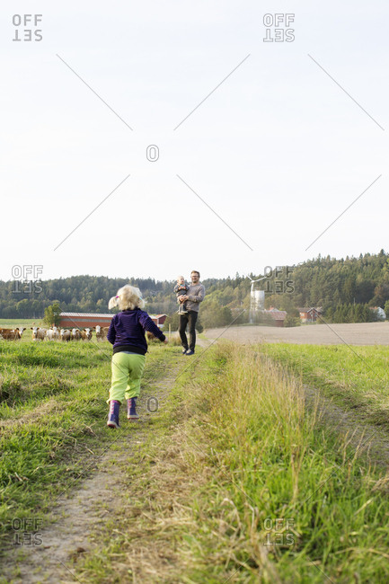 Man with his daughters on farm in Bergum, Sweden