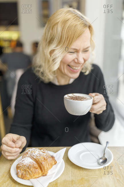 Woman at cafe in England