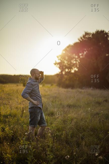 Man on field in Norra Rorum, Sweden