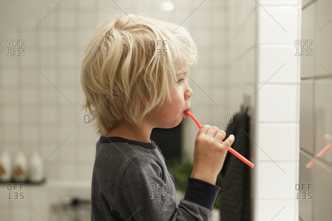 Boy brushing his teeth in Sweden