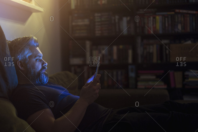 Man on sofa with tablet PC