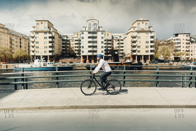 Man bicycling on street in Stockholm, Sweden