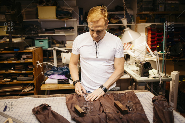 Man in leather workshop