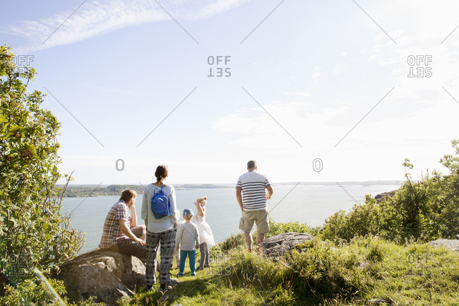 Family looking out to sea in Bohuslan, Sweden