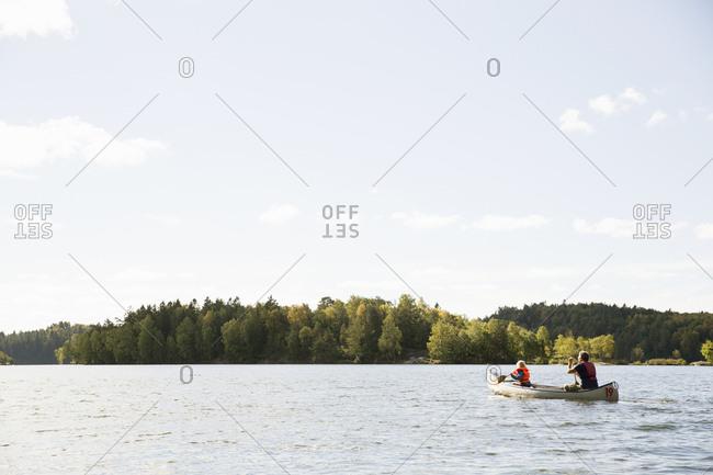Man in canoe with his daughter in Delsjon, Sweden