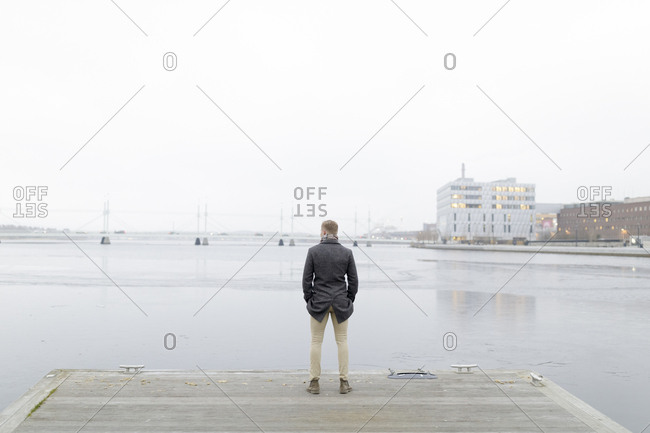 Man by waterfront in Smaland, Sweden