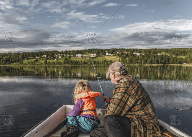 Grandfather and granddaughter fishing Borgvattnet, Sweden