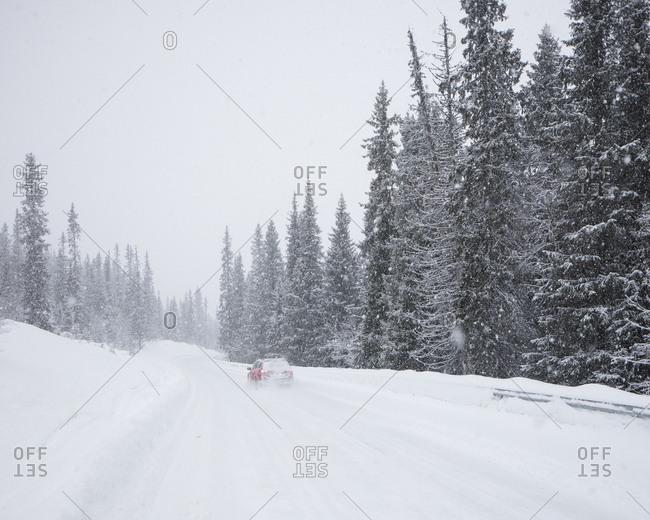 Car on snow covered road in Fulufjallet National Park, Sweden