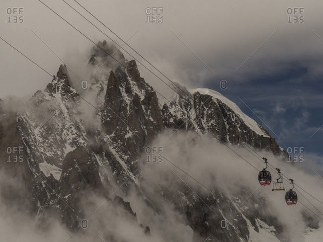 Chamonix-Mont-Blanc, France - July 28, 2017: Gondola going up mountains in the Alps