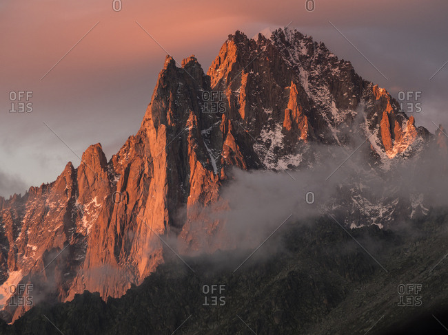 Mountain at sunset in the Alps