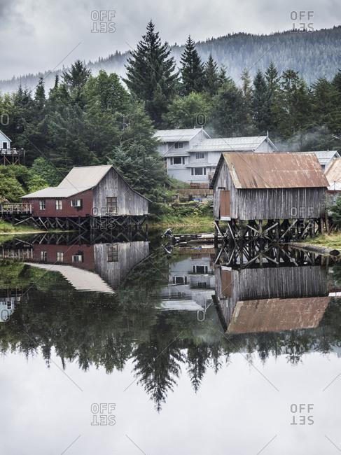 St. Petersburg, Alaska - August 25, 2017: Houses on stilts reflected in the water, Alaska