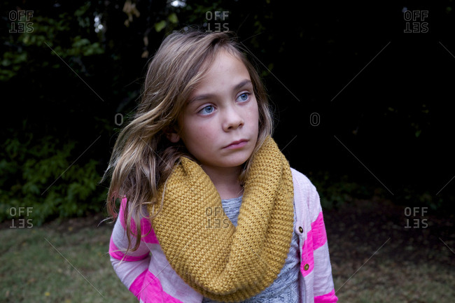 Girl in mustard colored scarf
