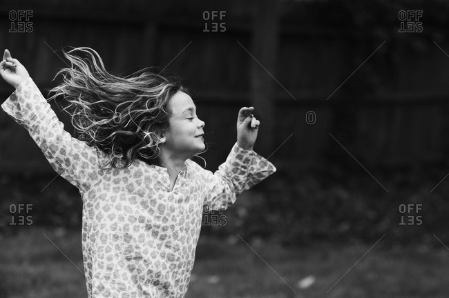 Girl frolicking with hair flowing behind her