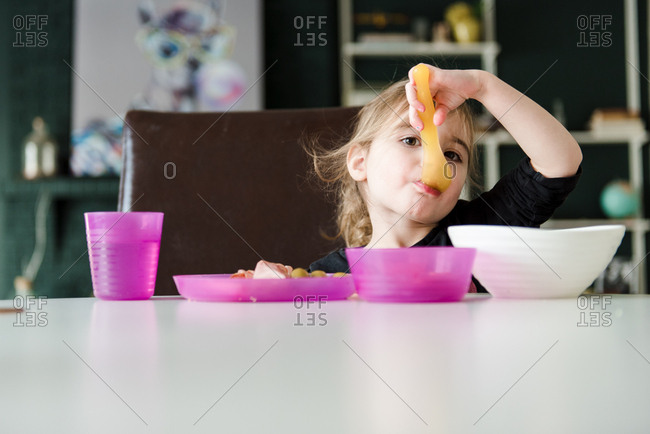Girl eating breakfast alone