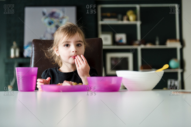 Young girl having a quiet lunch alone