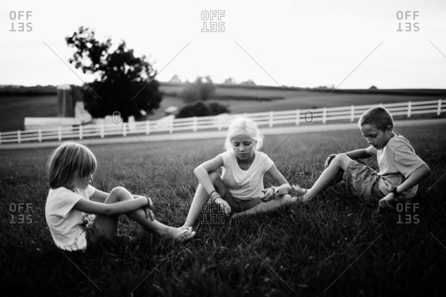 Children sitting in front yard