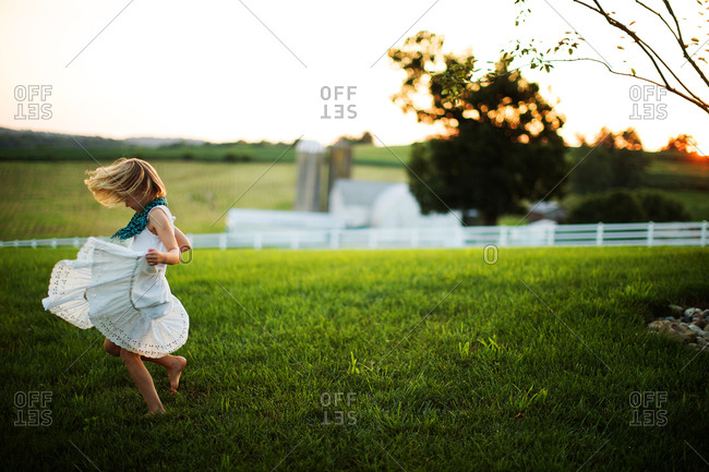 Girl dancing outside in dress