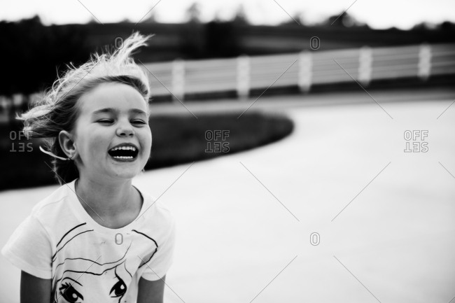 Girl laughing outside
