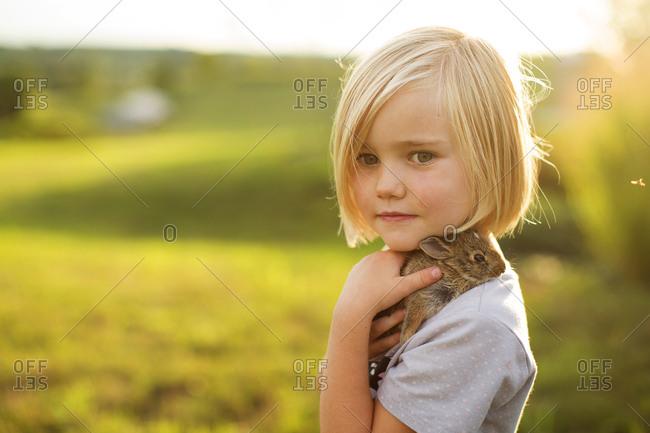 Girl holding baby bunny