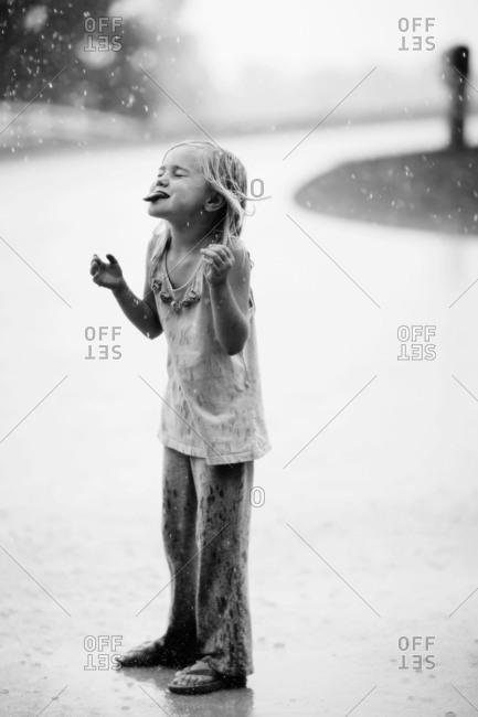 Girl playing in rain