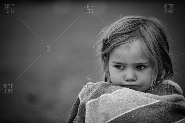 Girl sitting wrapped in towel