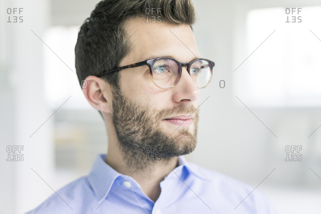 Portrait of businessman looking sideways