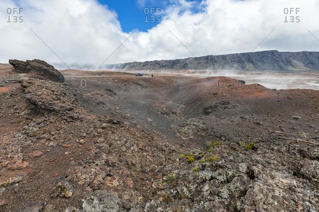 Reunion- Reunion National Park- Piton de la Fournaise- Route du volcan- Tourist in the Plaine des Sables