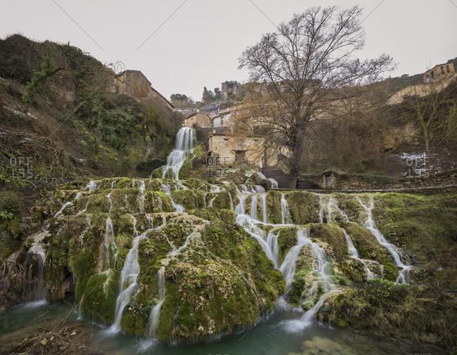 Spain- Burgos- Waterfall in village Orbaneja del Castillo