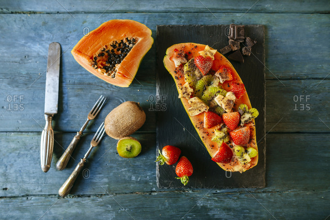 Papaya with kiwi- banana and strawberries with chocolate shavings on top