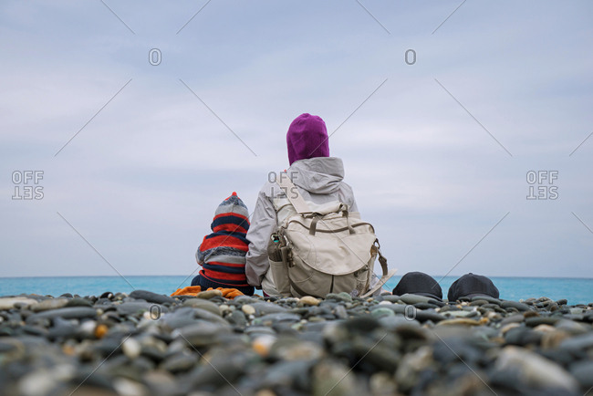 Taiwan, China-July 23, 2015: Mother and child sitting on the beach