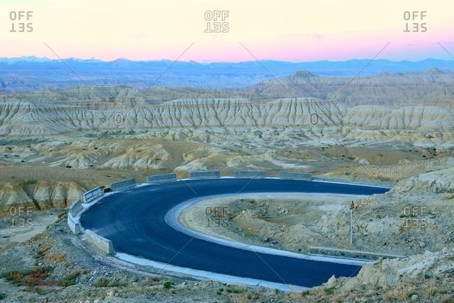 Trevor ariza to forest soil of highway in Tibet