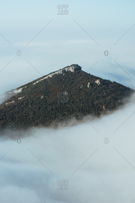 Mountain peak in thick clouds