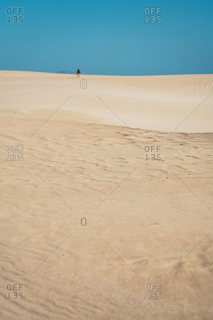 Anonymous traveler in sandy dunes
