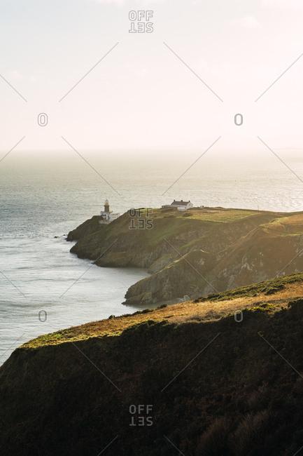 Big coastal rock and calm ocean