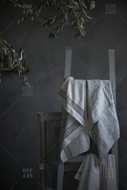 White cloth hanging on chair
