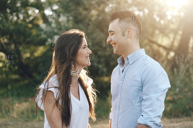 Couple looking each other and smiling in the countryside in Madrid, Spain