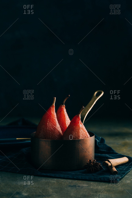 Poached pears in red wine with cinnamon and spices