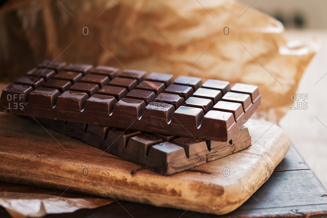 Dark chocolate bar in cutting board