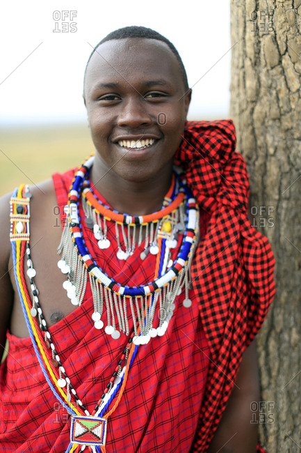 Masai Mara Game Reserve, Kenya, East Africa, Africa - September 6, 2017: Portrait of a Masai man wearing colorful traditional clothes