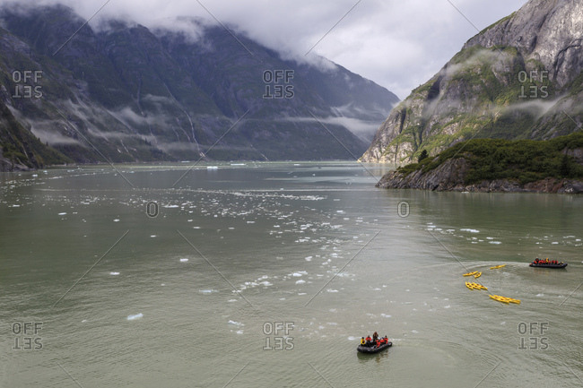 Tracy Arm Fjord, Alaska, United States of America, North America - September 1, 2017: Kayak expedition preparations, clearing mist, icebergs and cascades, near South Sawyer Glacier
