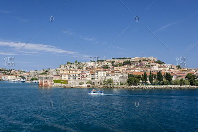 Portoferraio, Elba Island, Livorno Province, Tuscany, Italy, Europe - June 11, 2011: Historical Torre Della Linguella overlooking sea
