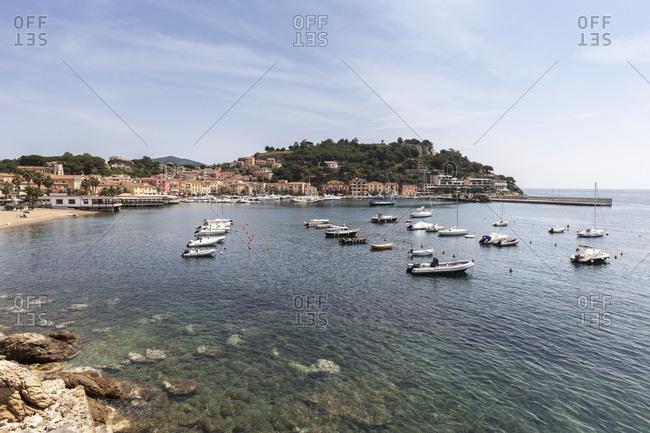 Porto Azzurro, Elba Island, Livorno Province, Tuscany, Italy, Europe - June 5, 2011: Boats moored in the harbor