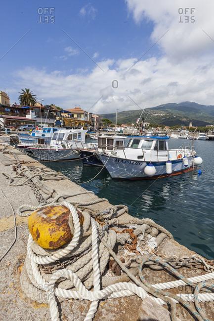 Marina Di Campo, Elba Island, Livorno Province, Tuscany, Italy, Europe - June 6, 2011: Boats moored in the harbor