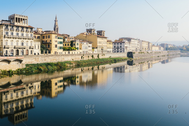 Florence, Tuscany, Italy, Europe - October 30, 2017: Reflection of buildings on River Arno